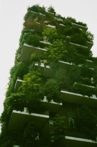 A high rise building covered in plants
